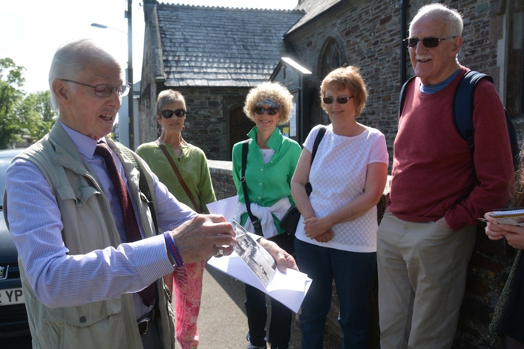 Inspecting a period photo, on the Causley Walk with Arthur Wills