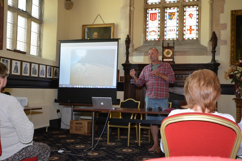 Tony Plant at the Guildhall, explaining his 'beach art'