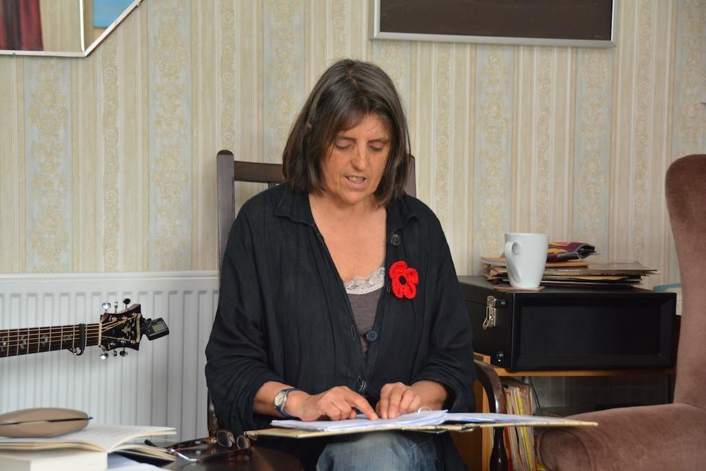 Anna Maria Murphy reading in the parlour at Cyprus Well