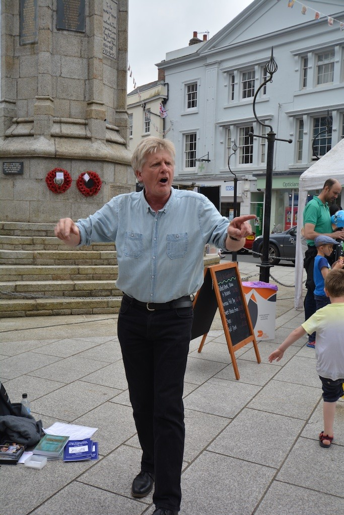 Delivering a pop-up poetic performance in the Square on the Saturday