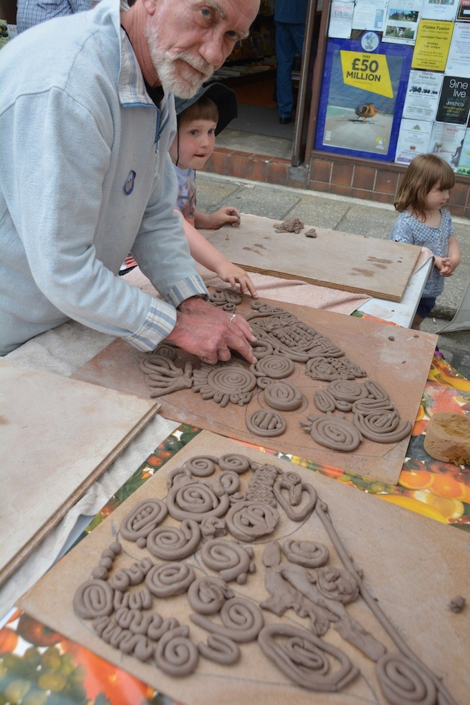 Getting stuck into the clay, during 'Fun in the Square'