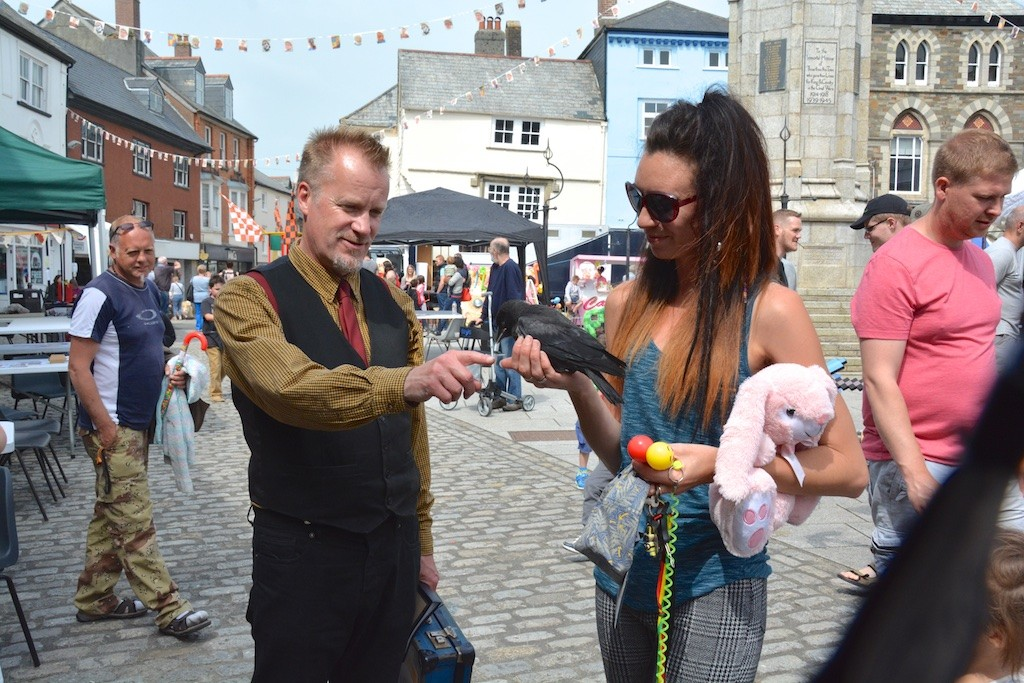 A Story Republic performer 'gets the bird' in the Town Square