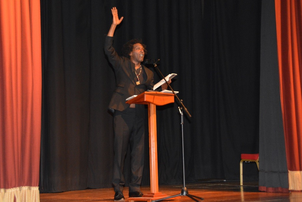 Lemn Sissay in a declamatory moment, onstage at the Town Hall