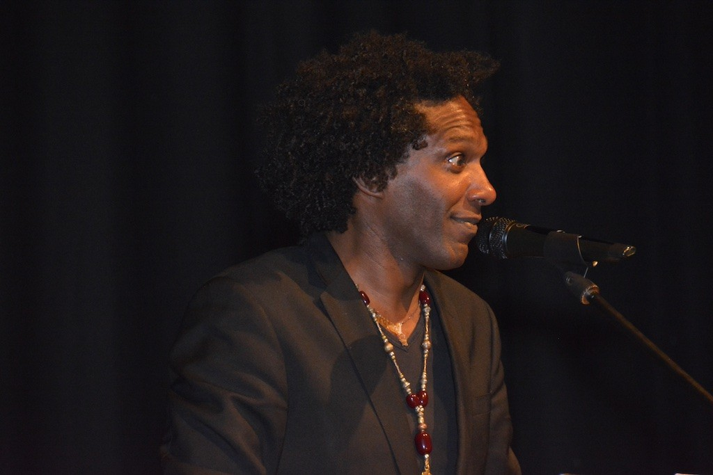 Lemn Sissay in the Town Hall, reflecting... rather quizzically