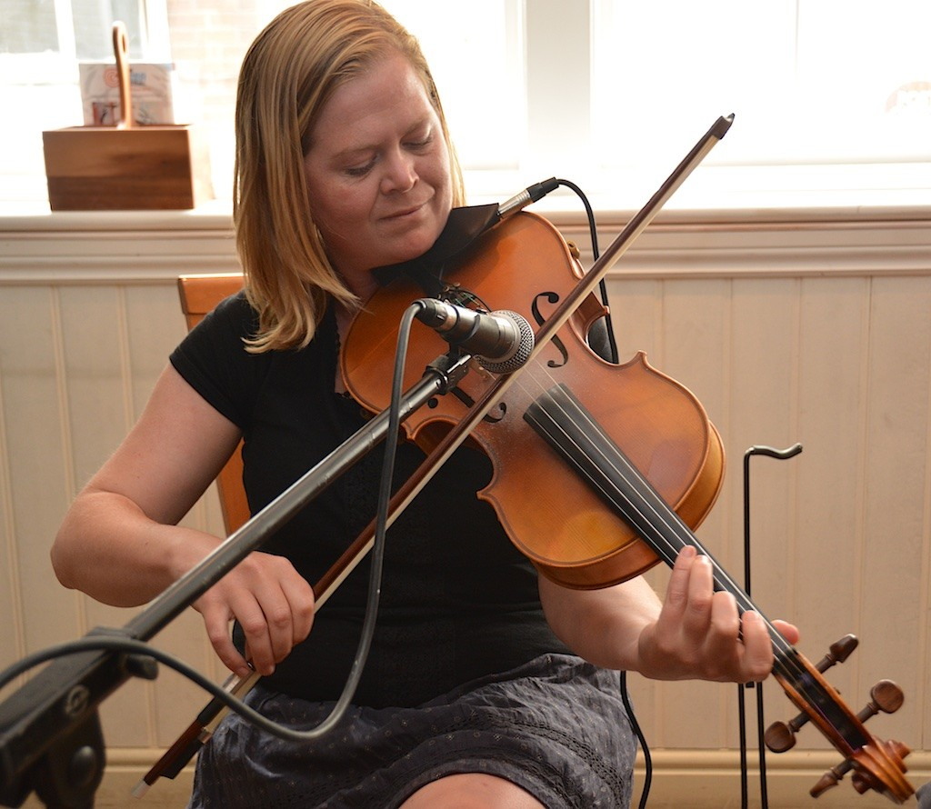 Jen Davy and her viola entertain the crowd at No. 8
