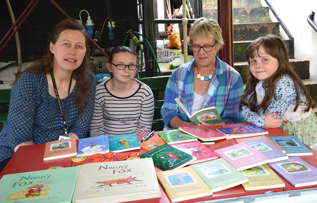 Local author Georgie Adams with fans at the Station